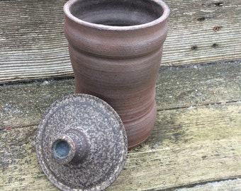 wood fired stoneware jar with lid.