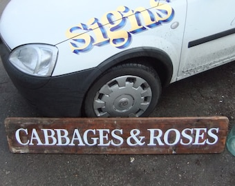 Distressed vintage Cabbages and Roses sign made from pine with white lettering