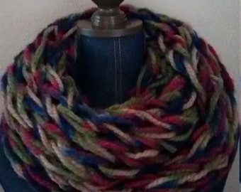 Handmade arm knit chunky Infinity scarf in rich blues, reds, greens and tan