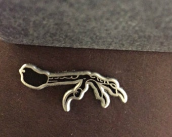 Raven claw pin