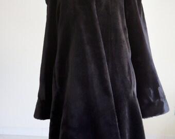 Vintage faux fur Coat black for Mrs. Article on sale.