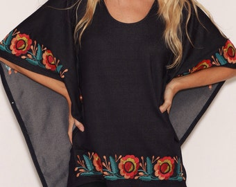 Knit denim poncho with tropical embroidery