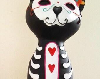Modern statue of a black cat