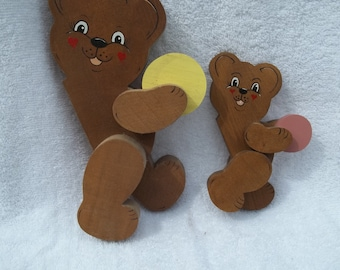 Two home made bears with wooden balls