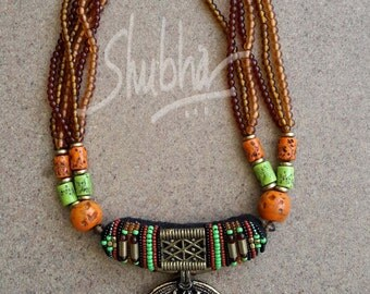 Golden and brown bead necklace ...