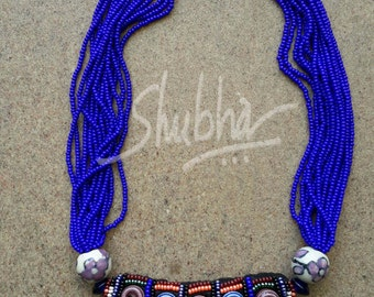 Bright blue bead necklace ...
