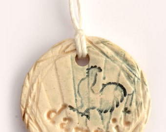 small ceramic pendant necklace with cursing and rooster