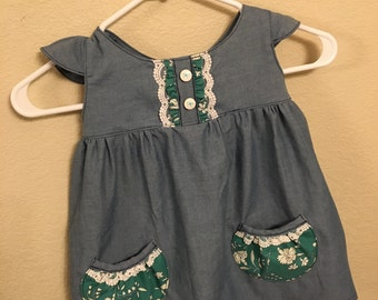 "Chambray ""Bree"" dress with flutter sleeves and customizable pockets."