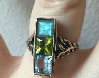 Labradorite, Peridot, and Sky Blue Topaz  in Bronze- The Indigo Ring