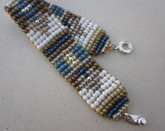 Aztec pattern blue and brown square stitch cuff bracelet with snap clasp
