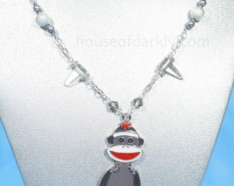 Sock Monkey oversized necklace with wiggly limbs, bead and glass spike accents
