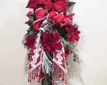 Victorian Vertical Christmas Door Swag in Traditional Red and White Poinsettia with Snowy Evergreens and Beaded Fringe Trimmed Bow