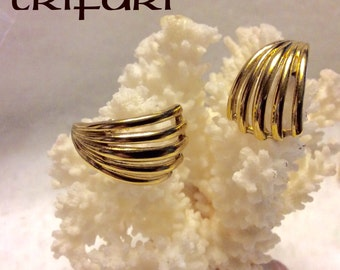 Designer signed Trifari cuff wrap gold metal pierced earrings.