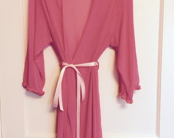 1980s sheer pink wrap nylon robe with ruffles on cuffs