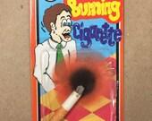 DOZEN 1960's - 70's Burning Cigarette Novelty Gag Mint in Packages