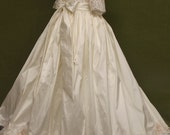 "Angela West  ""Marisol""  Christening gown size TBD. Acessories included custom monogram on slip"
