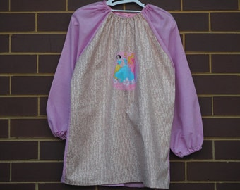 Age 9 to 12 girls craft apron, children's school art smock, long sleeve waterproof front. Pink princesses.