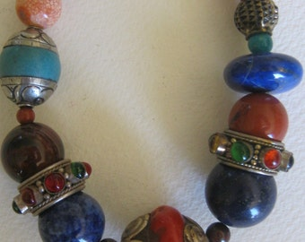 coral and lapis beads... handsome tribal elements.