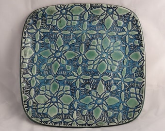 Green, glossy, textured, square, ceramic plate
