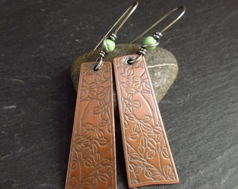 Embossed copper earrings with green turquoise bead, quatrefoil shape, antique copper, copper wedding anniversary gift, 7th anniversary