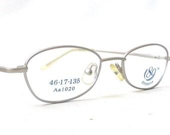 vintage 1990's NOS 189 eyewear eyeglasses matte silver wire oval frames prescription lenses womens mens eye glasses modern spring hinge