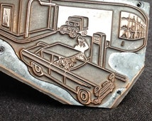Antique gas station and truck repair garage letterpress plate. Rescued printing printer supply.