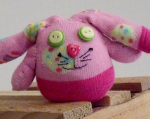 Sock Bunny Rabbit Made From a Pink Easter Sock  With Decorated Eggs and With Button Eyes and Nose with Hand Stitched Mouth And Pom Pom Tail
