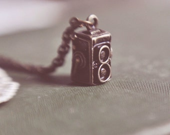 vintage camera necklace.