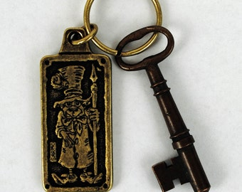 Art pendant jewelry key ring keychain metal brass Tom Sarmo original whimsical unique