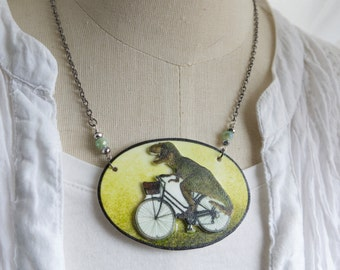 T-Rex Geekery Necklace on a Bicycle Dinosaur Statement Weird Wacky Jewellery Green Gifts Friend Sister Present Fun Fashion for Her Gift