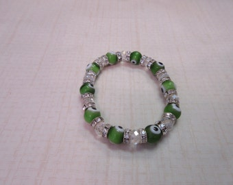 Green and clear evil eye bracelet with crystal spacers
