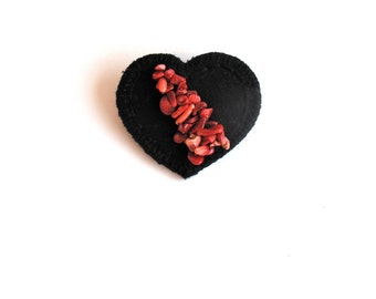 Black heart brooch embroidered with coral colored crystal beads on black cotton twill and black felt An Astrid Endeavor