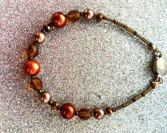 Brown and Bronze Pearl and Faceted brown and bronze Crystal Bracelet and brown seed glass seed beads app 7 inches by JulieDeeleyJewellery