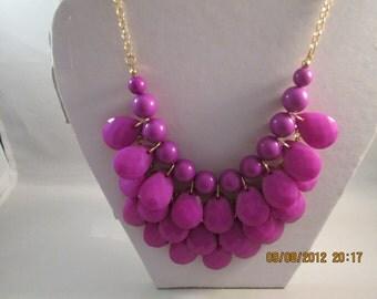 4 Row Bib Necklace with Purple Teardrop Bead Pendants on a Gold Tone Chain