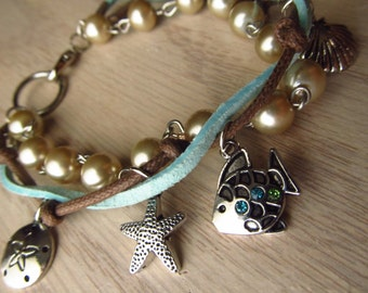ocean charm bracelet. sea shells and pearls.