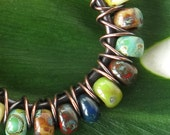 Multicolored picasso bead earrings - copper wire wrapped hoops