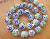 Murano glass flower 12mm round beads 16 inch strand