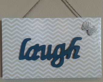 "Painted Wooden ""laugh"" sign"