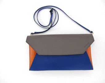 Leather clutch bag with removable strap. Available in many colors