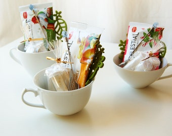 Relaxing Tea Cup Gift Set: 3 teabags, 3 flavored sugars, 1 felt coaster, 1 jeweled stir spoon all in a lovely tea cup