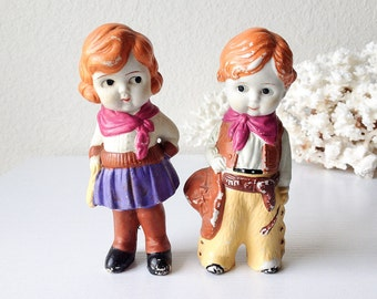 Vintage cowboy and cowgirl bisque doll Japan porcelain boy girl red hair cake topper set pair