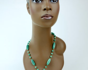 Green glass bead necklace, tourist medallion long gold tone Aztec
