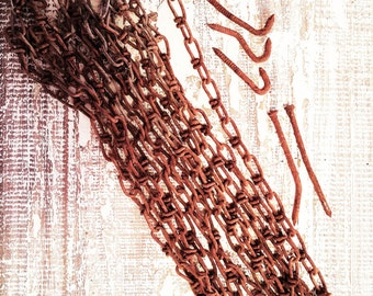 Rusty chain: 6- 27 inch pieces with assorted rusty nails. Use for art, to hang repurposed pieces and more