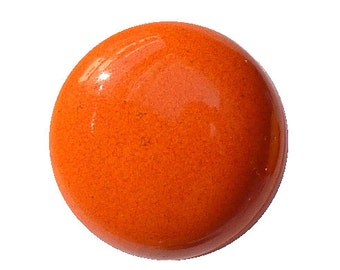 Orange enameled ceramic button. Closer clip.