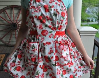Vintage full apron, fruit pattern, red, white, pink, green. Apples, pears, lemons, cherries. Red crisscross straps, sash. 1950's retro cool!