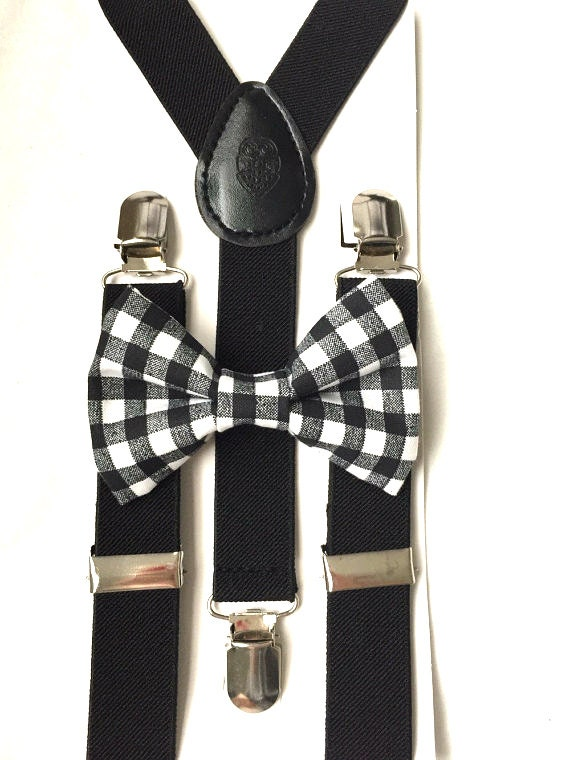 black suspenders and black and white checkered bow tie