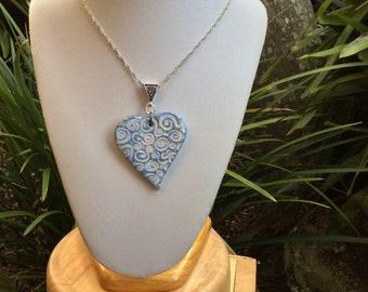 Heart patterned impression porcelain necklace.