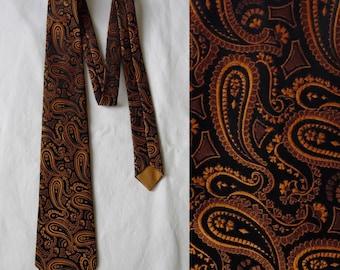 Paisley tie cravat, black orange patterned, textured vintage French polyester neck tie