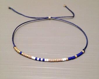Delicate layering bracelet Friendship bead bracelet silk