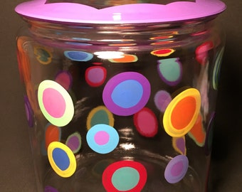cookie or dog treat jar with plum edge and colorful polka dots